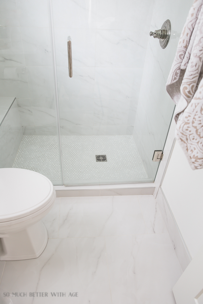 Faux Carrara Marble Porcelain Tile/penny tile on shower floor - So Much Better With Age