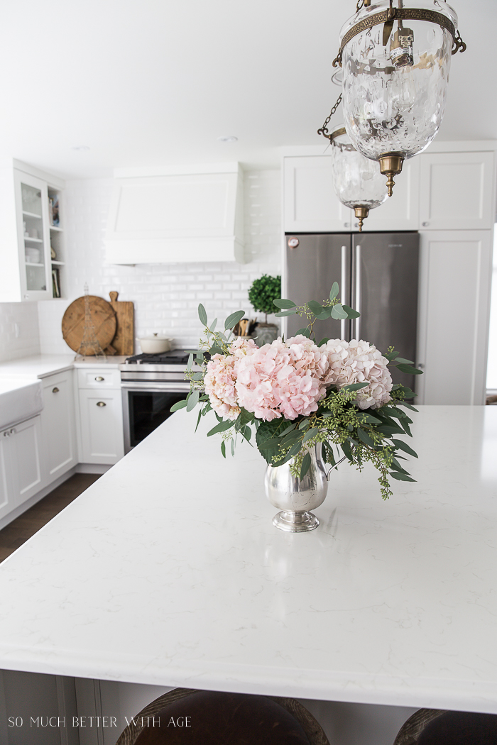 Canadian Spring Tour/ white kitchen, pink hydrangeas - So Much Better With Age
