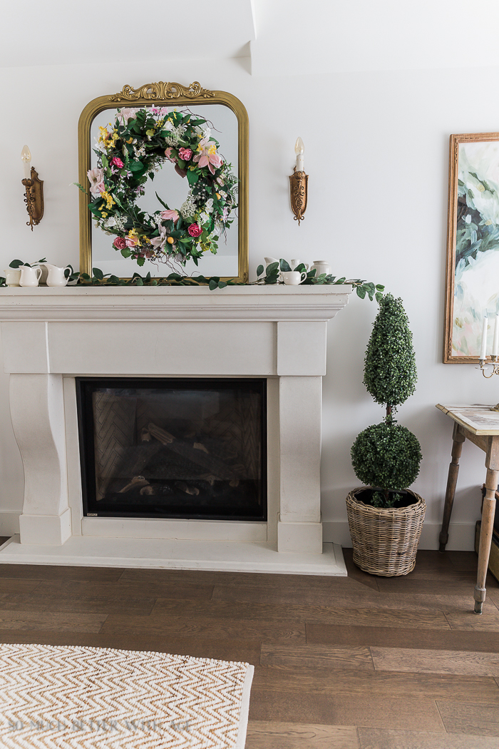 Spring Decorating with Balsam Hill/wreath and topiary by fireplace - So Much Better With Age