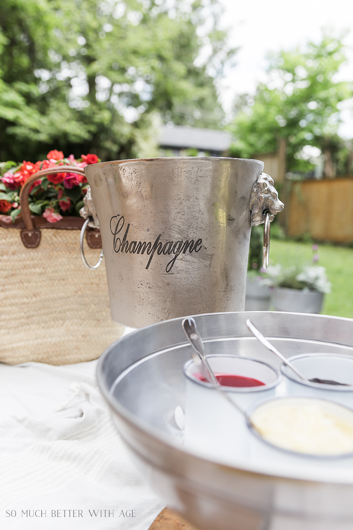 Champagne bucket on table outside.