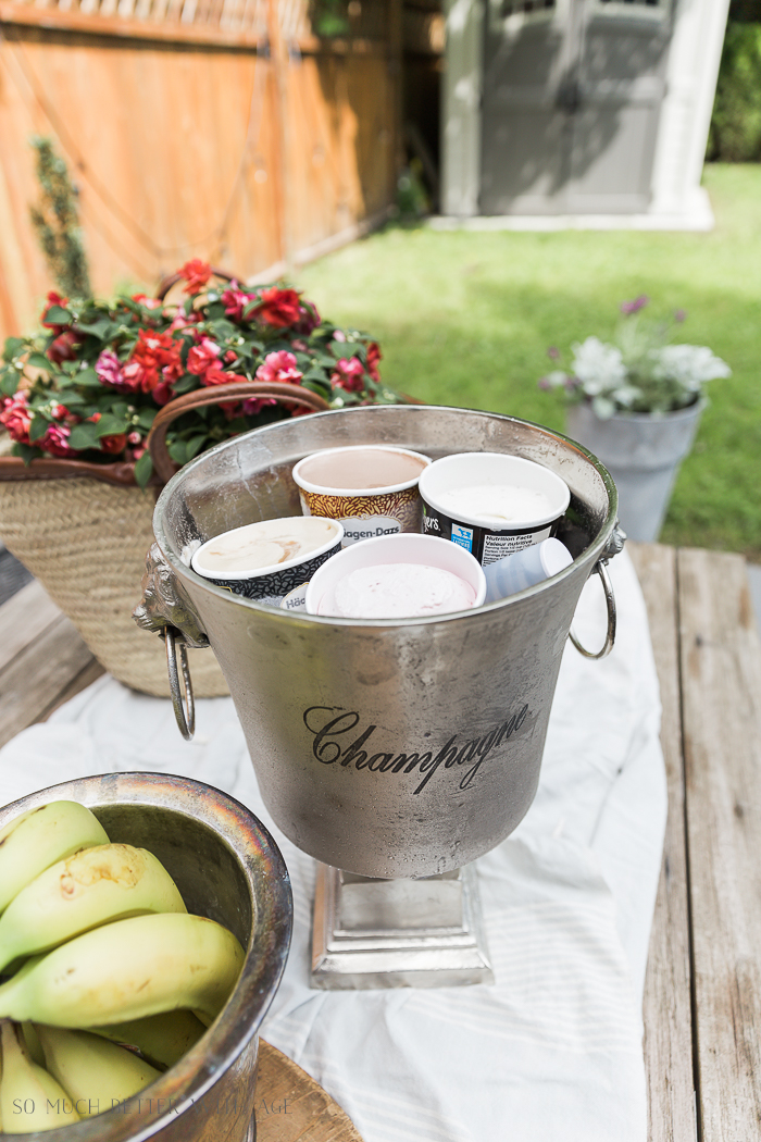 Ice tubs in a champagne bucket outside.