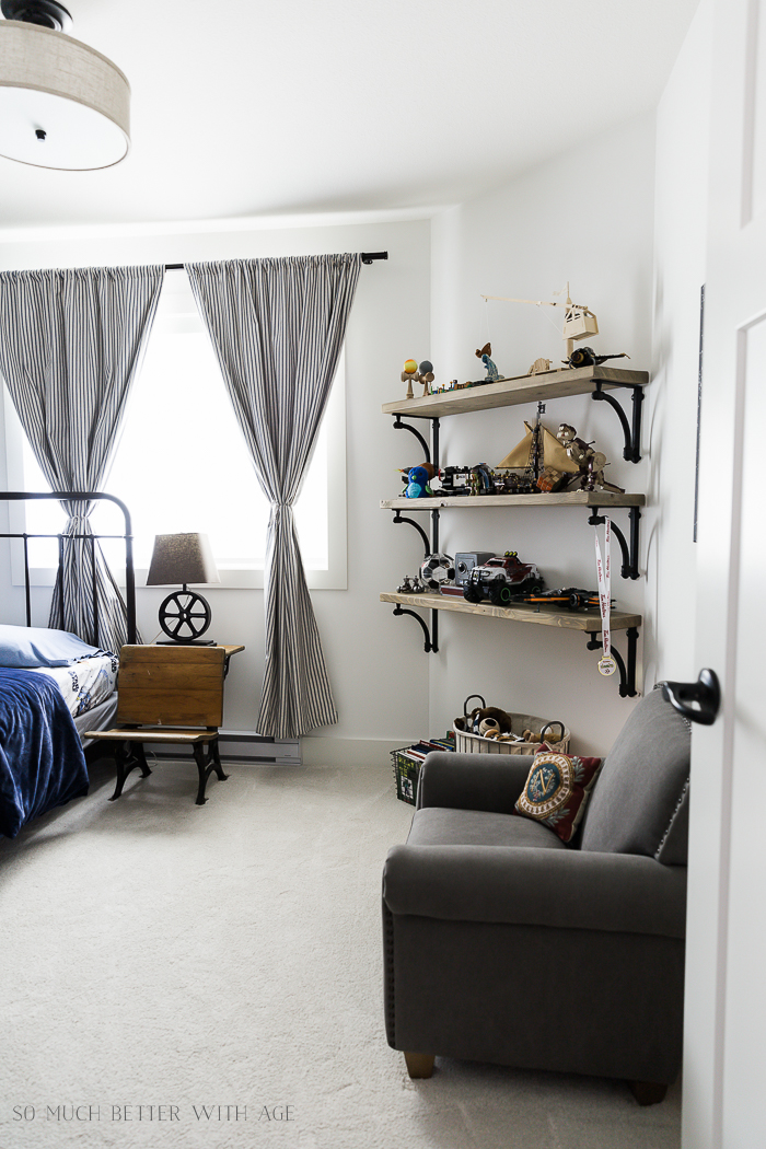 Industrial Space Boy's Bedroom Reveal/mini club chair, wooden shelves - So Much Better With Age