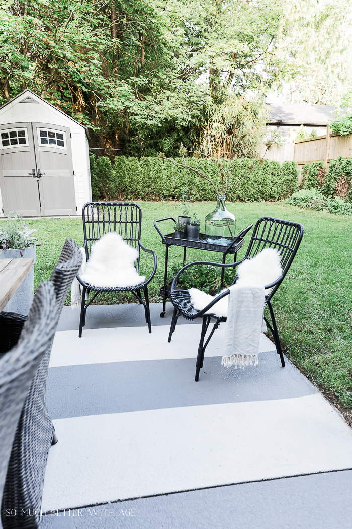 How to Create Two Outdoor Seating Areas in Small Space/black chairs - So Much Better With Age