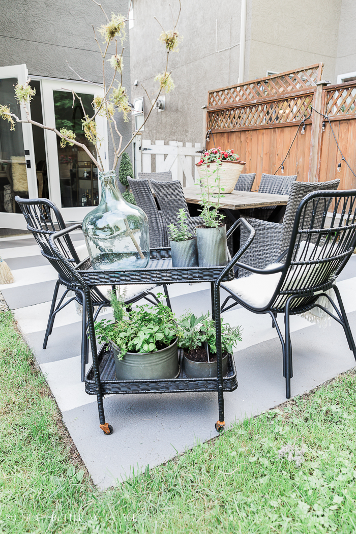 How to Create Two Outdoor Seating Areas in Small Space/black outdoor chairs - So Much Better With Age