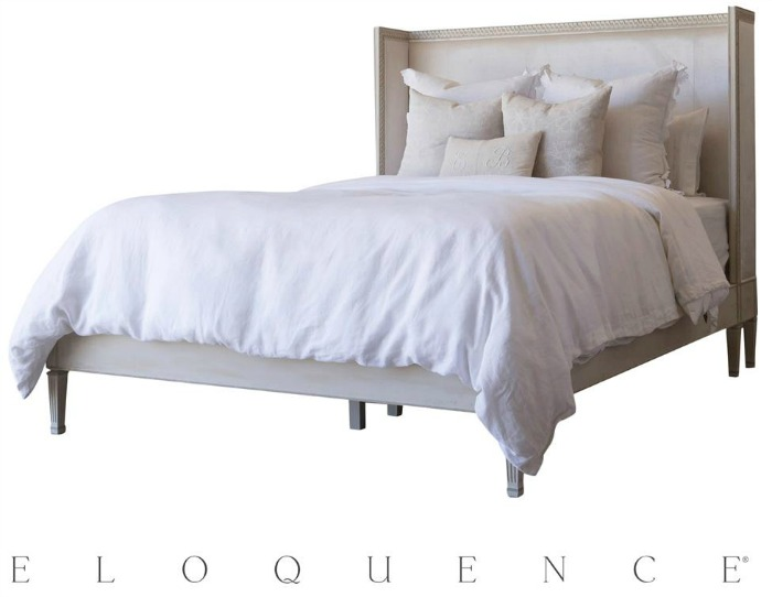 Antique bed frame in grey with white bedding.
