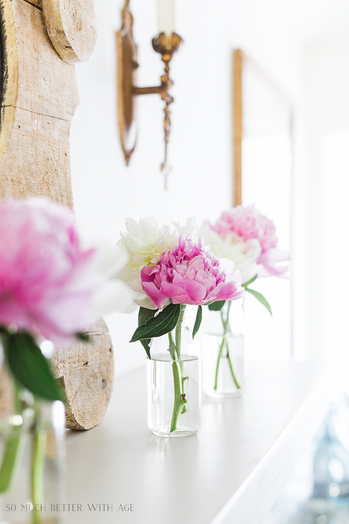 Simple Summer Mantel with Peonies/pink and white flowers in milk jars - So Much Better With Age