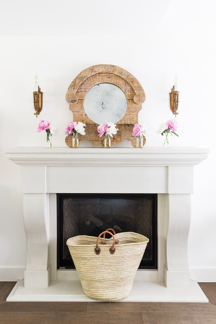 Pink and white flowers on mantel.