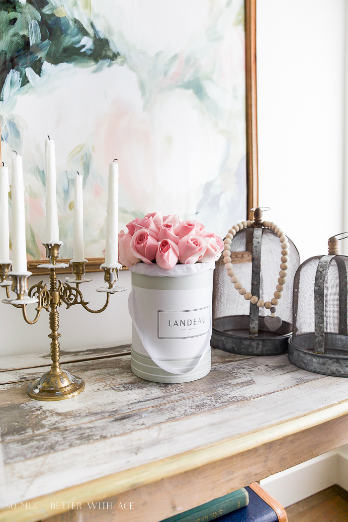 Roses in a Landeau vase on mantel.