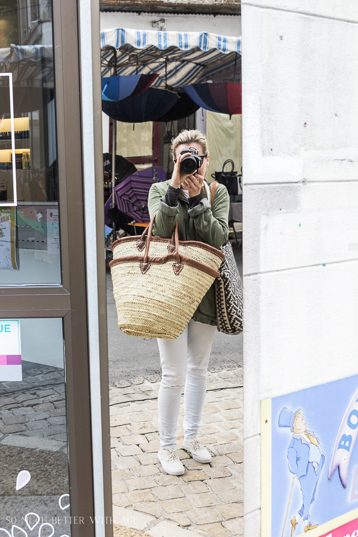 Shopping in Riberac, France/taking photo in mirror with baskets - So Much Better With Age