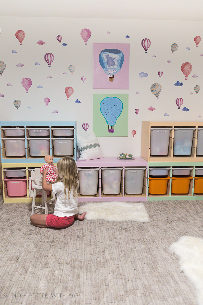 Kids' Playroom Makeover with Hot Air Balloons/girl playing with doll - So Much Better With Age
