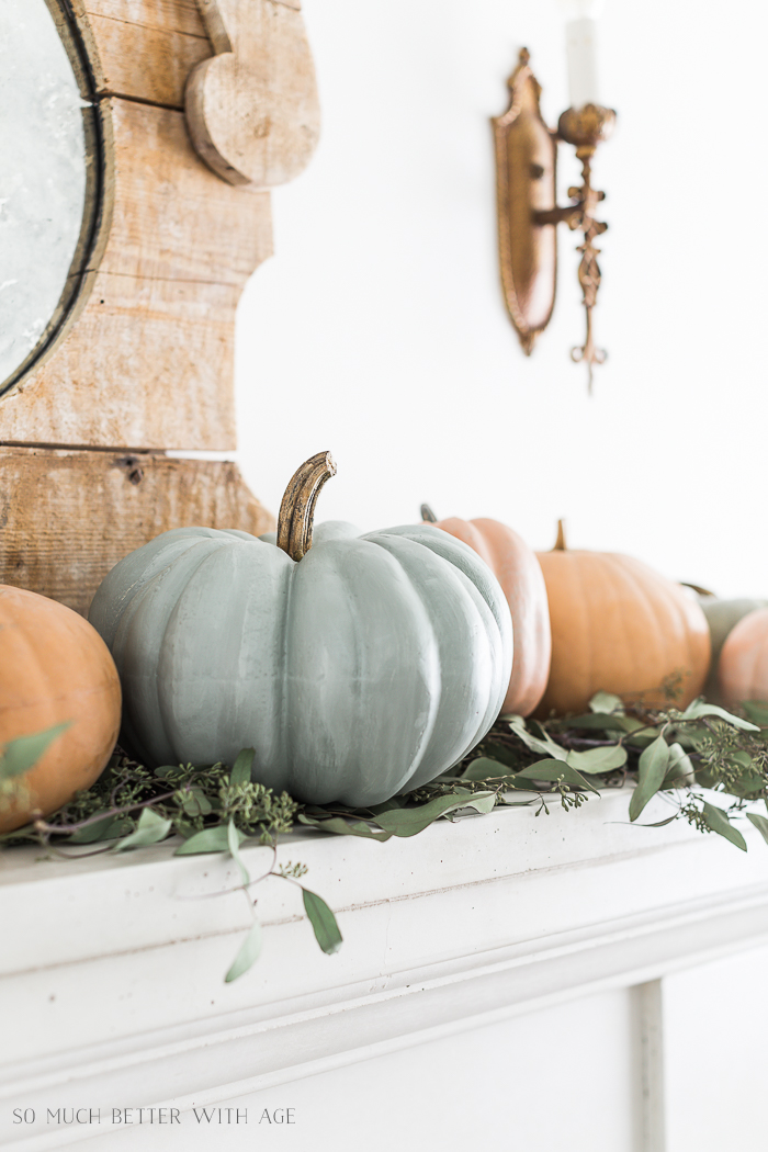 Painting Pumpkins in Muted Colors/sage green pumpkin on mantel.