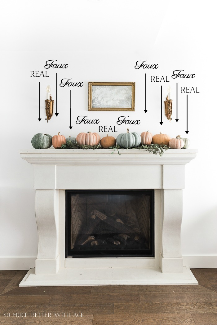 Mixing real and faux pumpkins on the mantel with arrows pointing to the real ones and the faux ones.