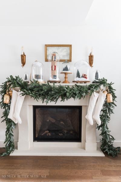 Christmas Mantel Decor with Snow Globe Cloches