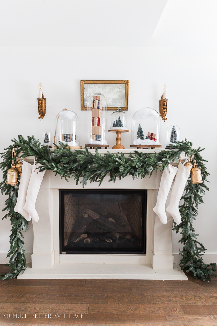 christmas mantel decor with snow globe cloches so much better with age