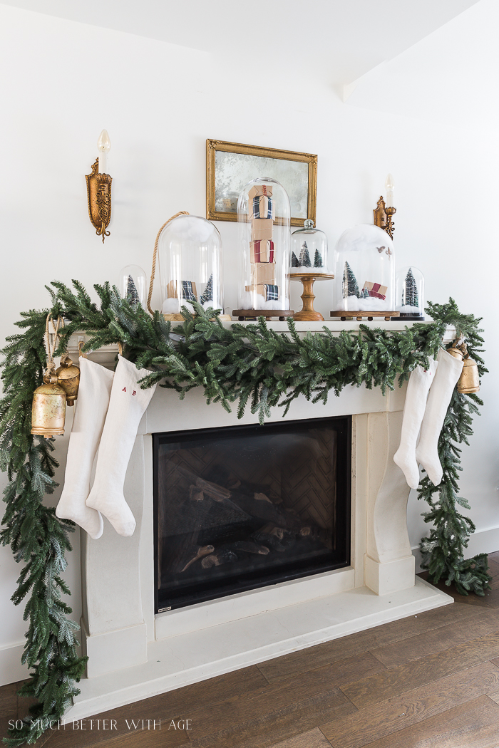 Christmas Mantel Decor with Snow Globe Cloches/garland on mantel - So Much Better With Ag