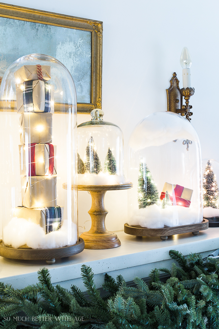 Christmas Mantel Decor with Snow Globe Cloches/Christmas lights in cloches - So Much Better With Ag