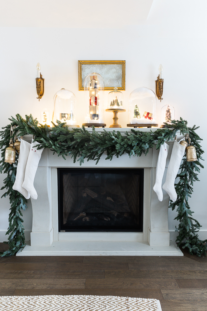 Christmas Mantel Decor with Snow Globe Cloches/Christmas lights and garland - So Much Better With Ag