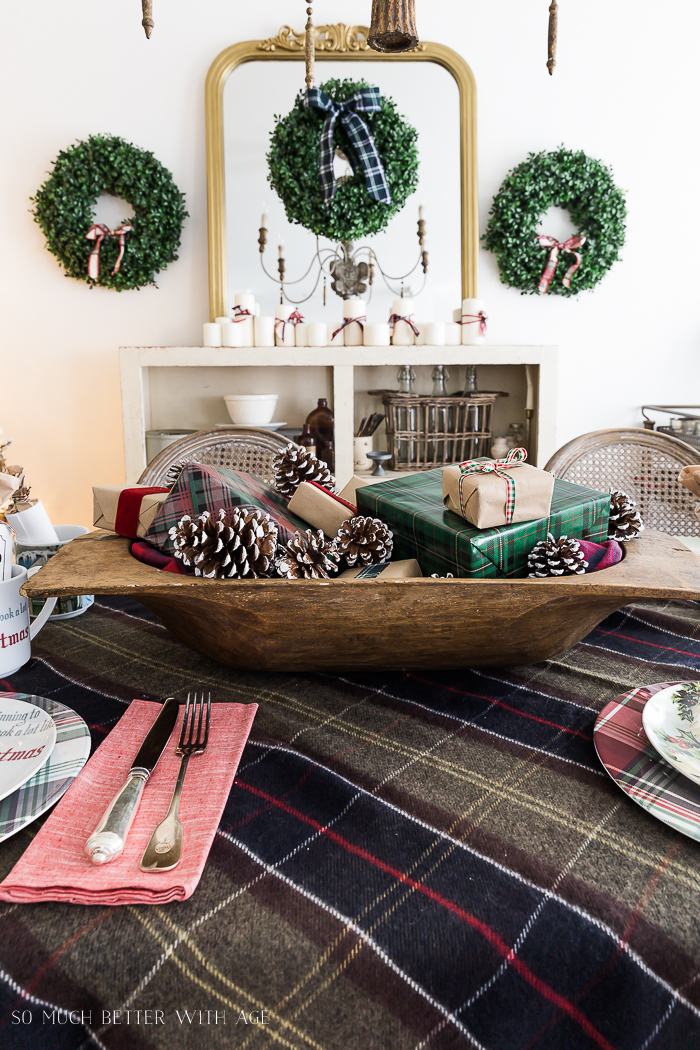 Christmas Plaid Table Setting/dough bowl centrepiece - with pinecones, wrapped present in a plaid pattern.