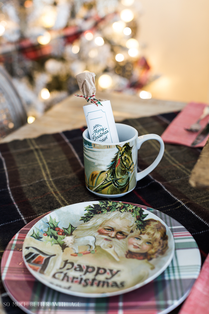 A santa vintage looking plate, and coffee mug with a horse on it on the table.