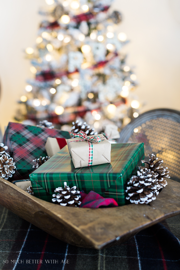 Christmas Plaid Table Setting/gifts wrapped in dough bowl with plaid bow on top.