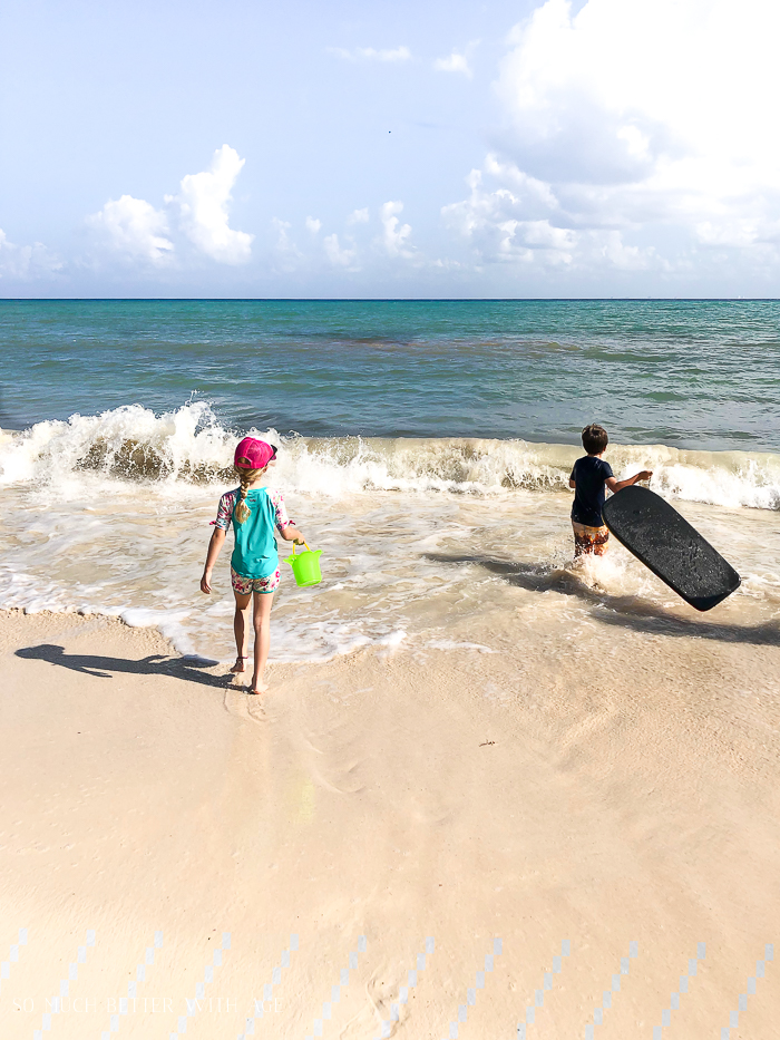 Tropical Family Vacation Packing List/kids playing on beach - So Much Better With Age