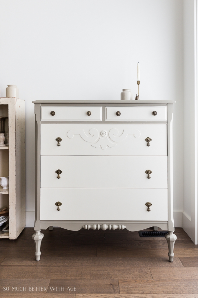 Grey dresser with white drawers.