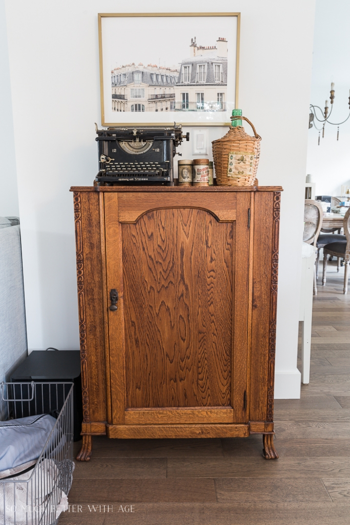 Oak cabinet with vintage typewriter sitting on top.