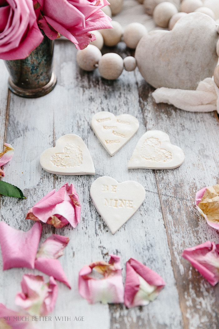 The mini hearts with decorations etched inside them.