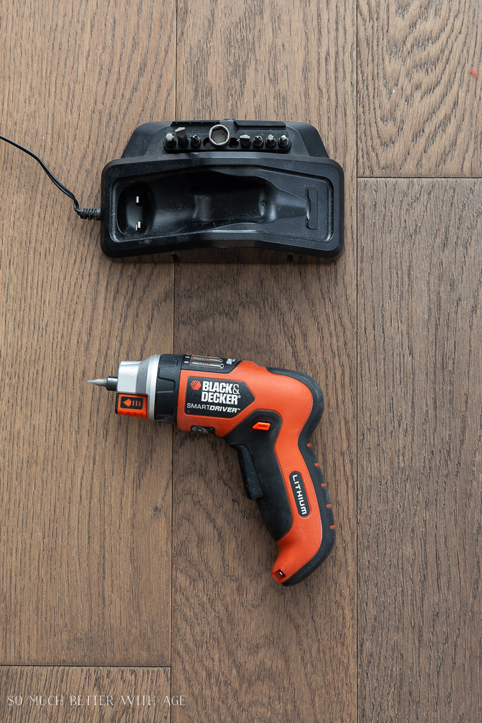 16 Essential Tools for Do-It-Yourself (DIY) Projects/electric screwdriver sitting beside its charger.