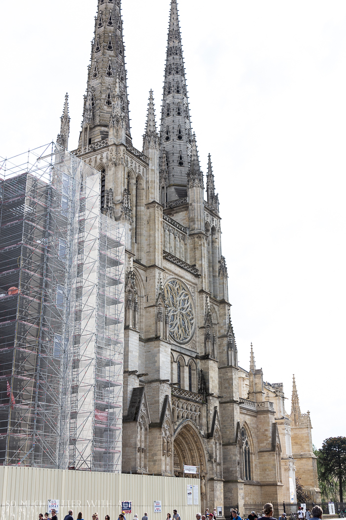 Restoring the cathedral with work being done on one side of it.