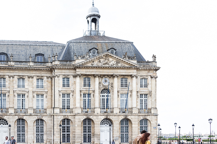 Why You Must Visit Bordeaux with a large historic building in the picture.