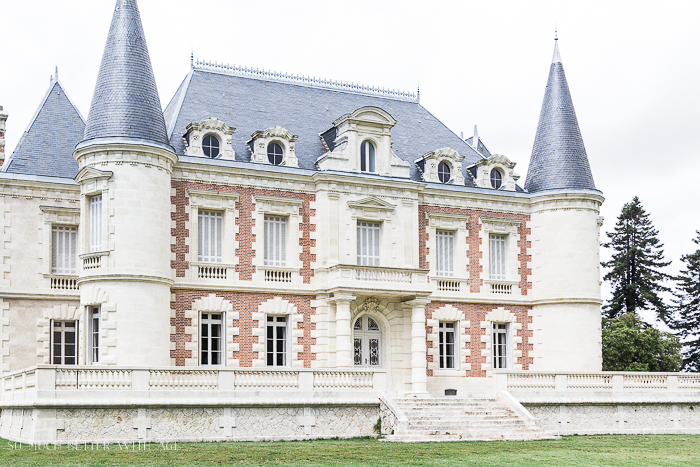 A beautiful old chateau with red and white brick.