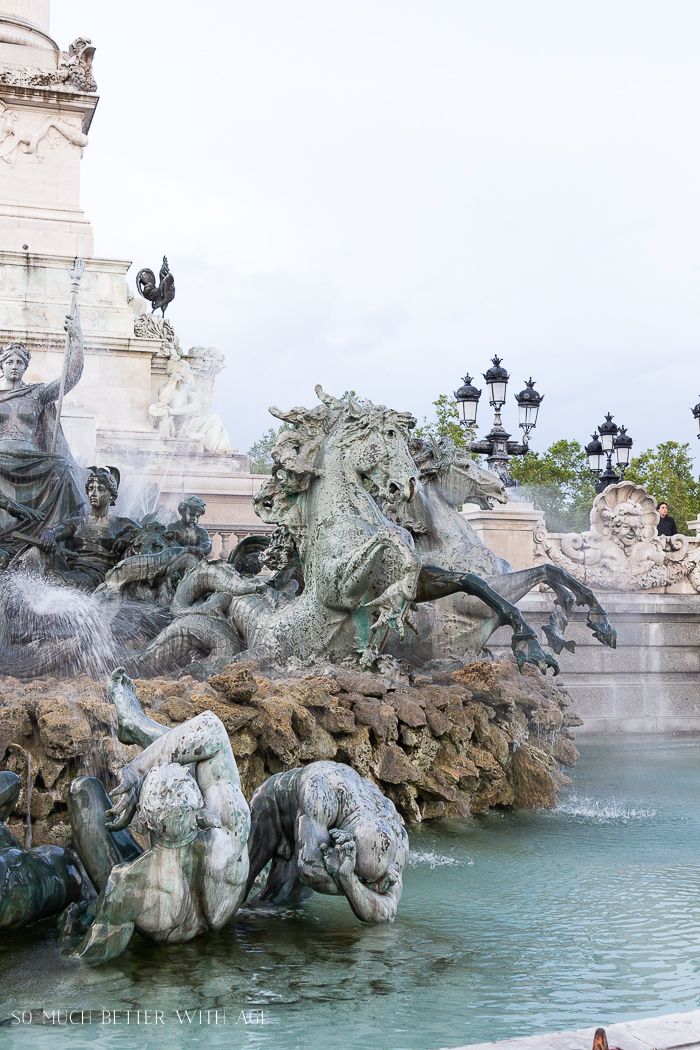 Horses and mermaids are the details in the fountain.