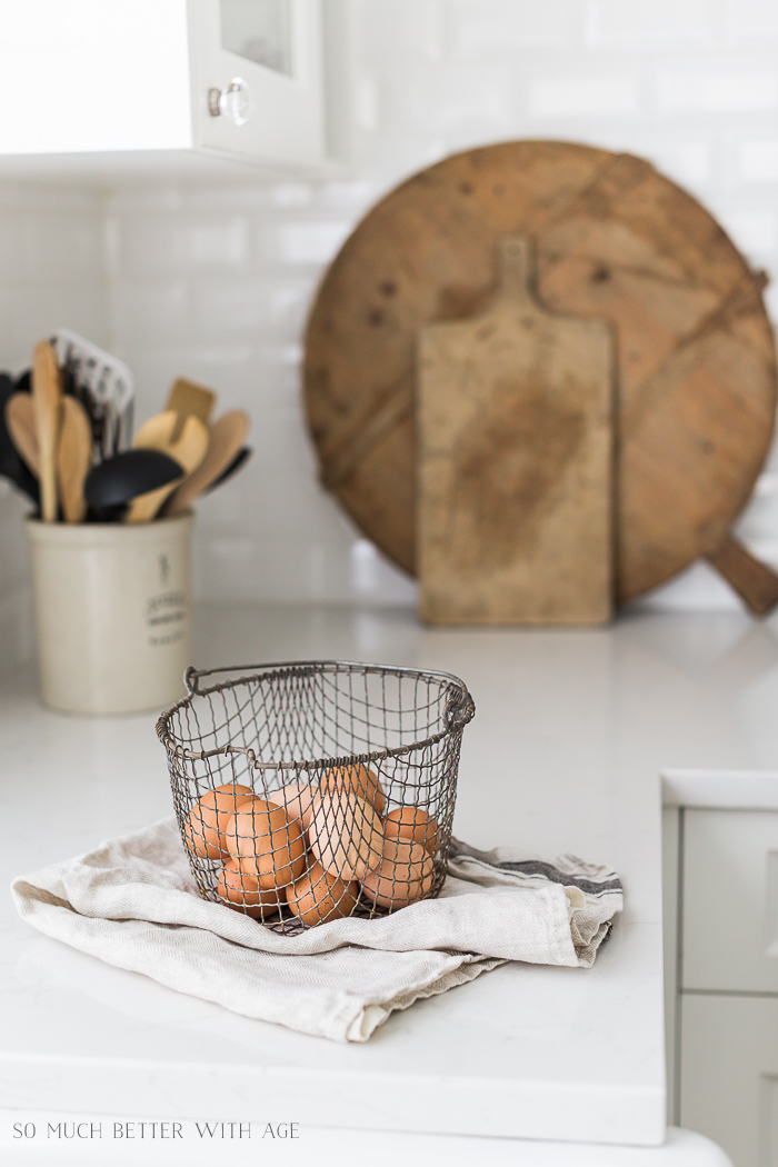 Simple Spring Decor Ideas/eggs in metal basket - So Much Better With Age
