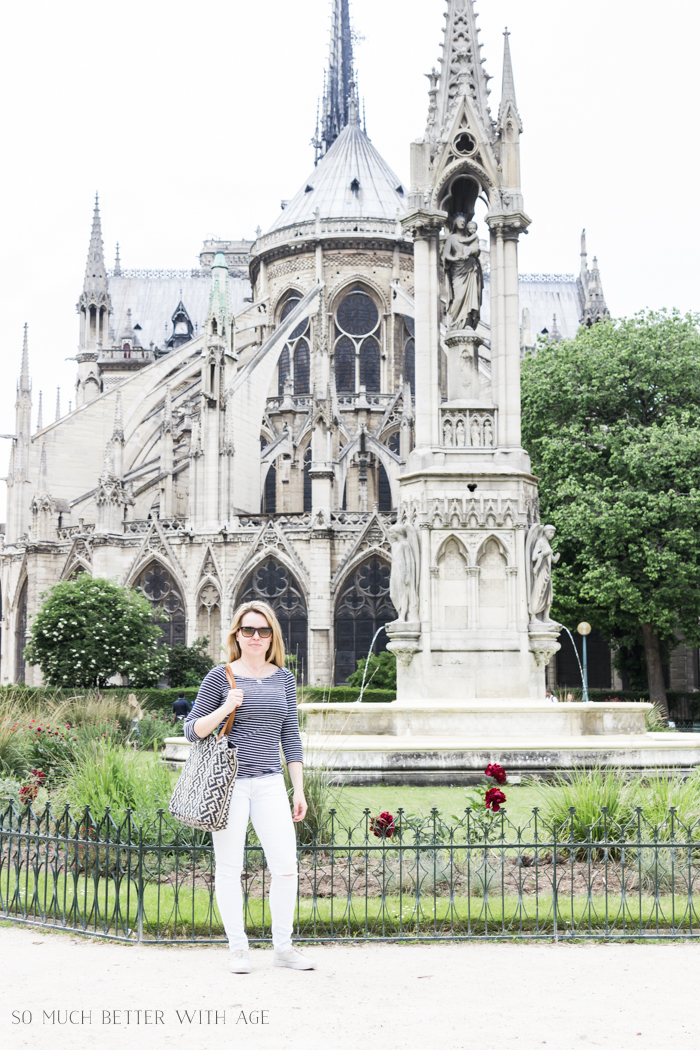 Top 10 Things to See & Do Your First Time in Paris/Jamie posing in front of Notre Dame - So Much Better With Age