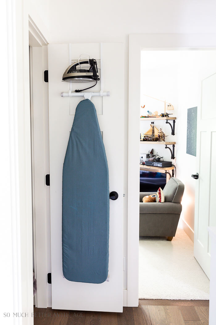 Bathroom Minimalism | How I Organize Small Bathrooms/ironing board and iron hanging on door - So Much Better With Age