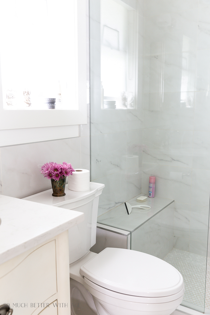 Bathroom Minimalism | How I Organize Small Bathrooms/marble bathroom, pink flowers - So Much Better With Age
