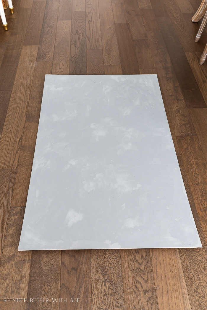 Grey board on hardwood floors.