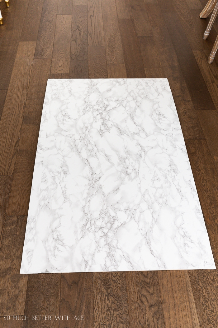 Marble board on hardwood floor.