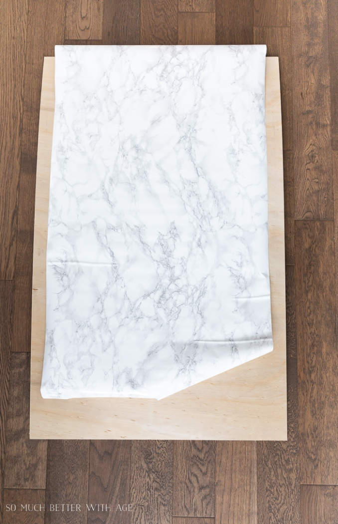 Marble contact paper over board.