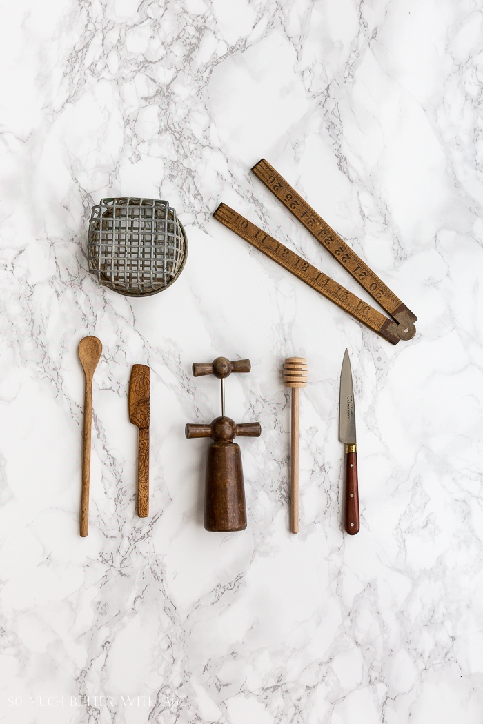 Vintage objects on marble backdrop.