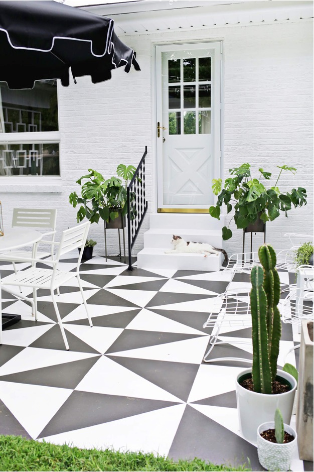 Geometric black and white pattern on outdoor patio.