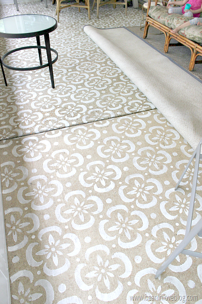 Beige floor with white pattern on it.