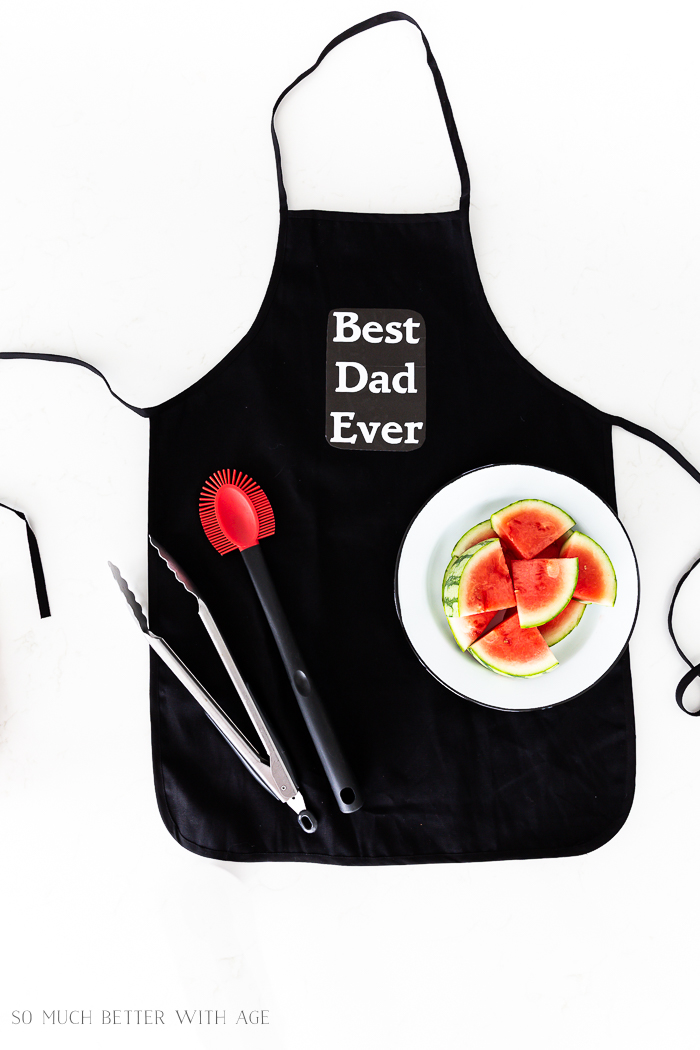 Best Dad Ever black apron with watermelons.