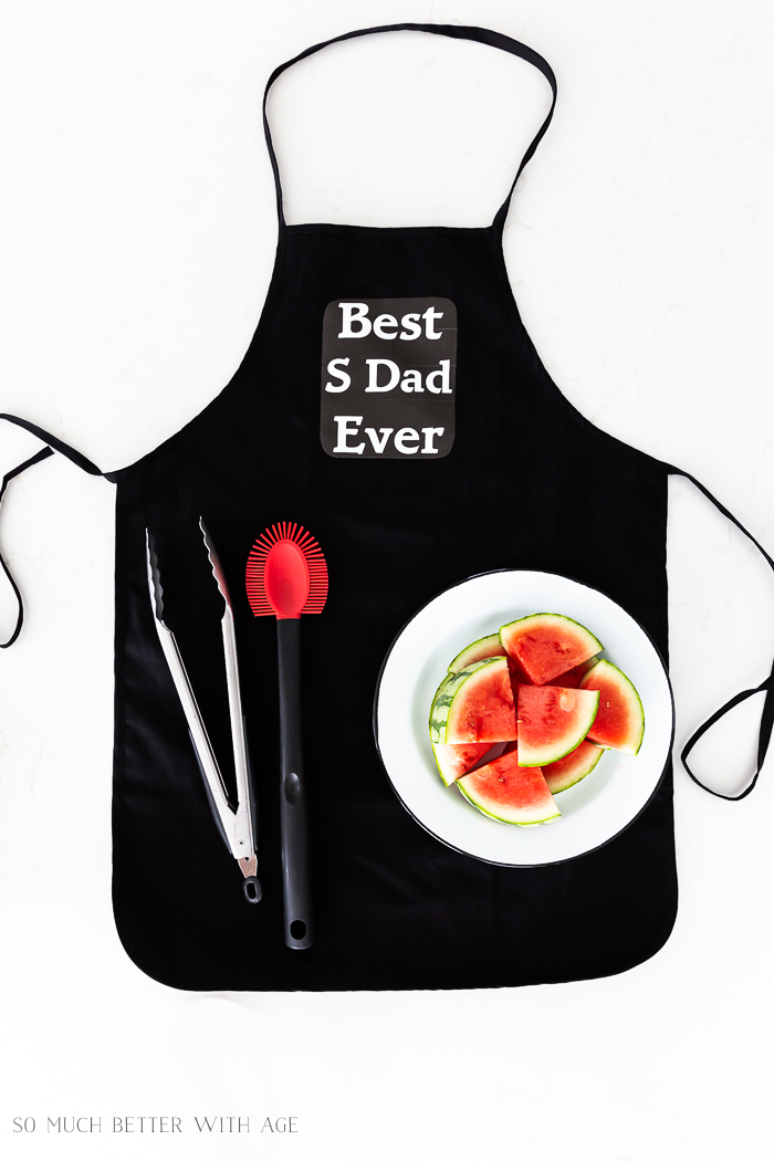Best step dad ever black apron with watermelon slices.