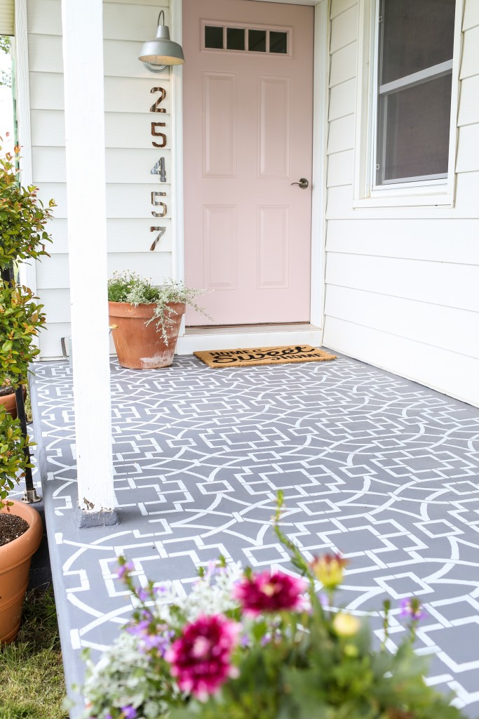 Grey and white pattern on front door landing.