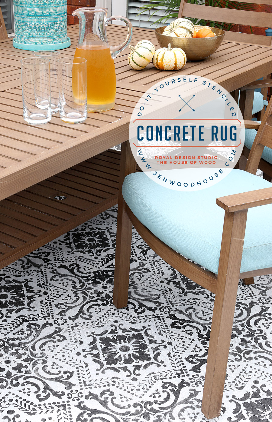 Patio wood table on stencilled concrete.