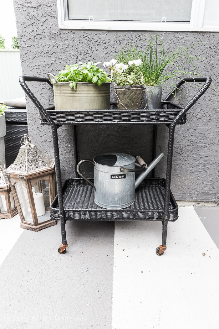 Black cart with plants.