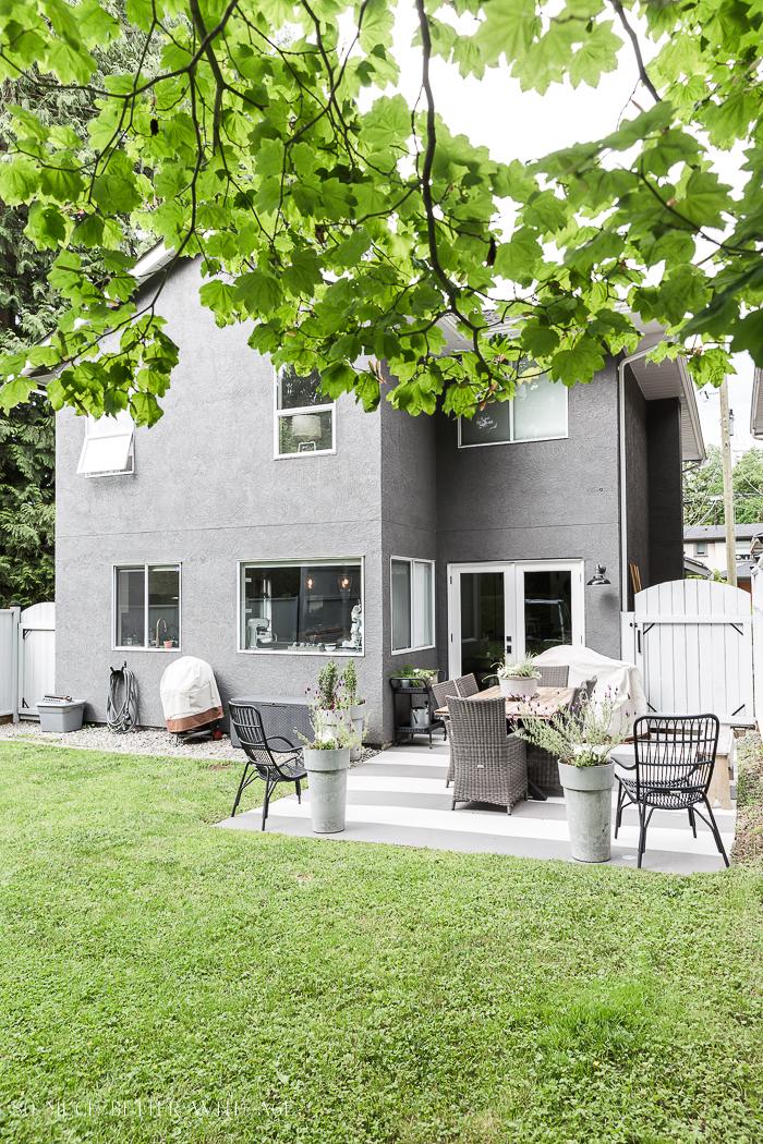 Backyard with grey house.
