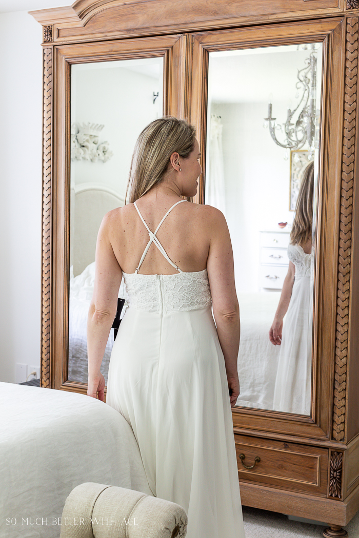 Criss cross back straps on wedding dress.